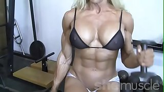 Sexy Blond Female Bodybuilder In See Through Top Works Out